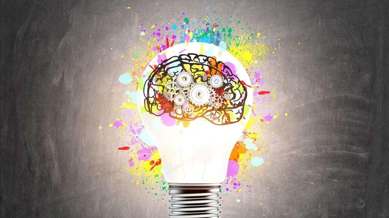 Brain inside lightbulb showing understanding