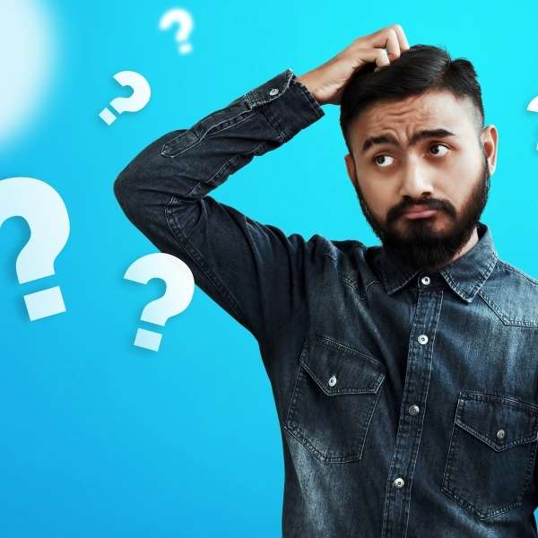 Man scratching head with question marks floating around him